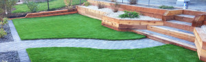retaining wall and paving stone path backyard